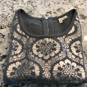 Moth, gray sweater with silver brocade.